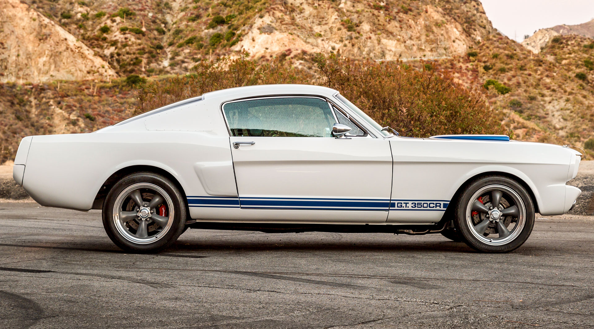 1965 Shelby GT350CR next to mountains
